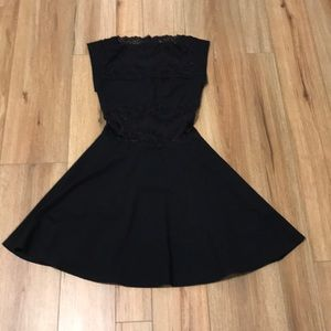 Bebe black lace dress with sheer lace panel size s
